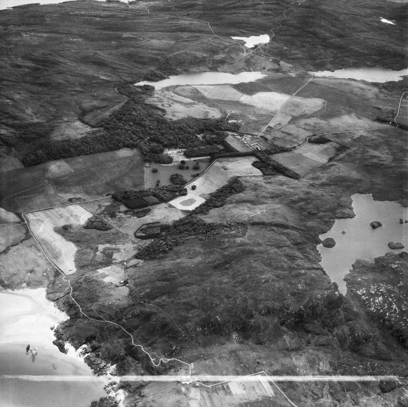 Kiloran, general view, showing Colonsay House, Kiloran and Beinn an Sgoltaire.  Oblique aerial photograph taken facing south.  This image has been produced from a crop marked negative.