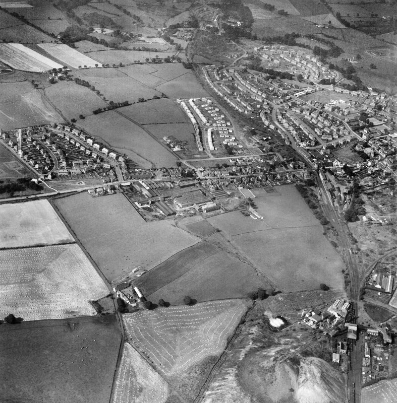 Denny, general view, showing Cruikshank and Co. Ltd. Denny Iron Works, Glasgow Road and Dryburgh Avenue.  Oblique aerial photograph taken facing west.  This image has been produced from a crop marked negative.