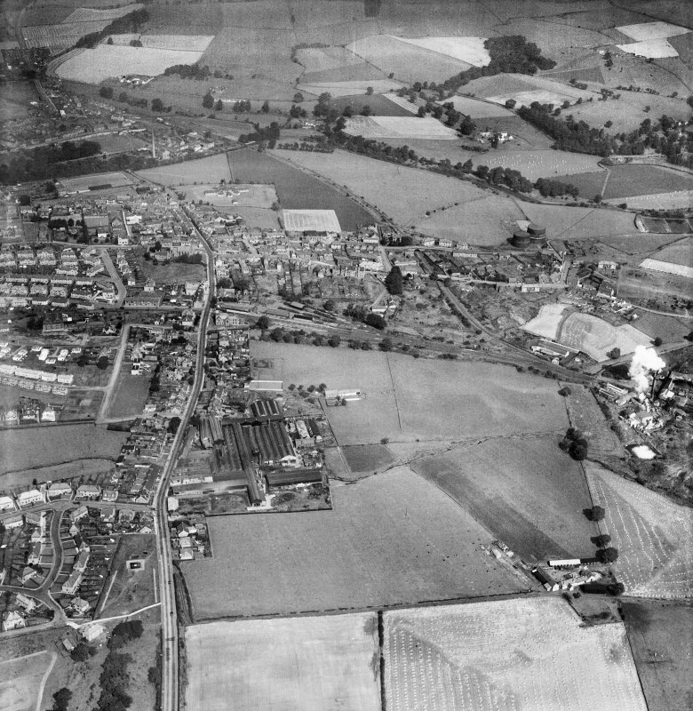 Denny, general view, showing Cruikshank and Co. Ltd. Denny Iron Works, Glasgow Road and Denny Gasworks.  Oblique aerial photograph taken facing north.  This image has been produced from a crop marked negative.