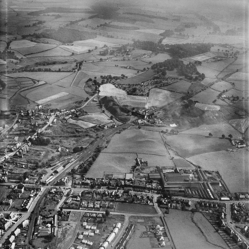 Denny, general view, showing Cruikshank and Co. Ltd. Denny Iron Works, Glasgow Road and Herbertshire Colliery.  Oblique aerial photograph taken facing east.