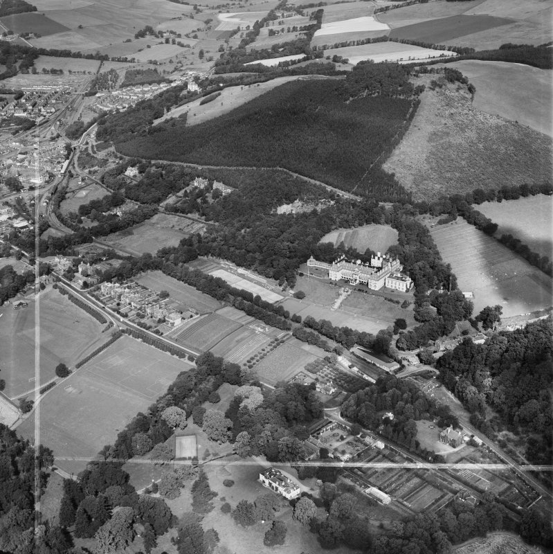 Peebles, general view, showing Hydropathic Hotel, Innerleithen Road and Ven Law.  Oblique aerial photograph taken facing north.  This image has been produced from a crop marked negative.