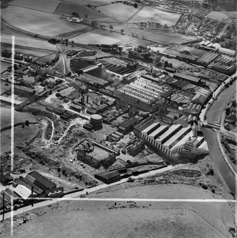 Bonnybridge Gasworks and Smith and Wellstood Ltd. Columbian Stove Works, Bonnybridge.  Oblique aerial photograph taken facing south.  This image has been produced from a crop marked negative.
