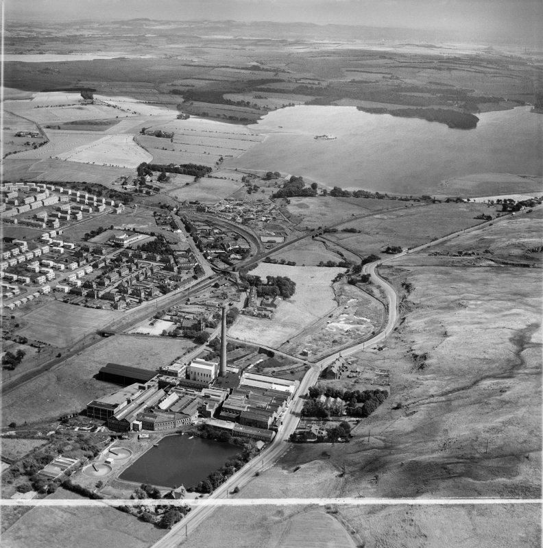 Caldercruix, general view, showing Robert Craig and Sons Ltd. Caldercruix Paper Mills, Airdrie Road and Hillend Reservoir.  Oblique aerial photograph taken facing east.  This image has been produced from a crop marked negative.