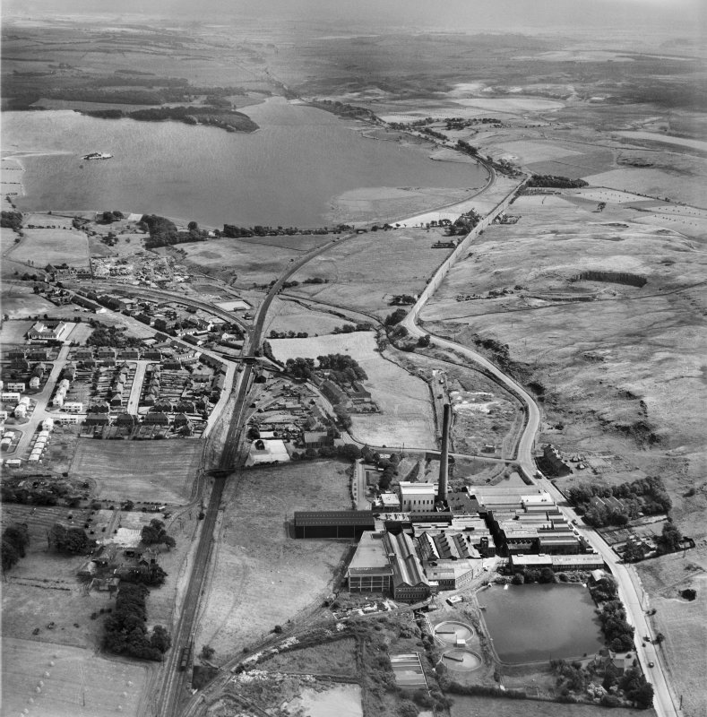 Caldercruix, general view, showing Robert Craig and Sons Ltd. Caldercruix Paper Mills, Airdrie Road and Hillend Reservoir.  Oblique aerial photograph taken facing east.
