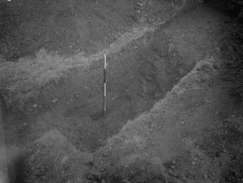 Cairnpapple Hill, photograph of excavation showing henge ditch on E sdie.