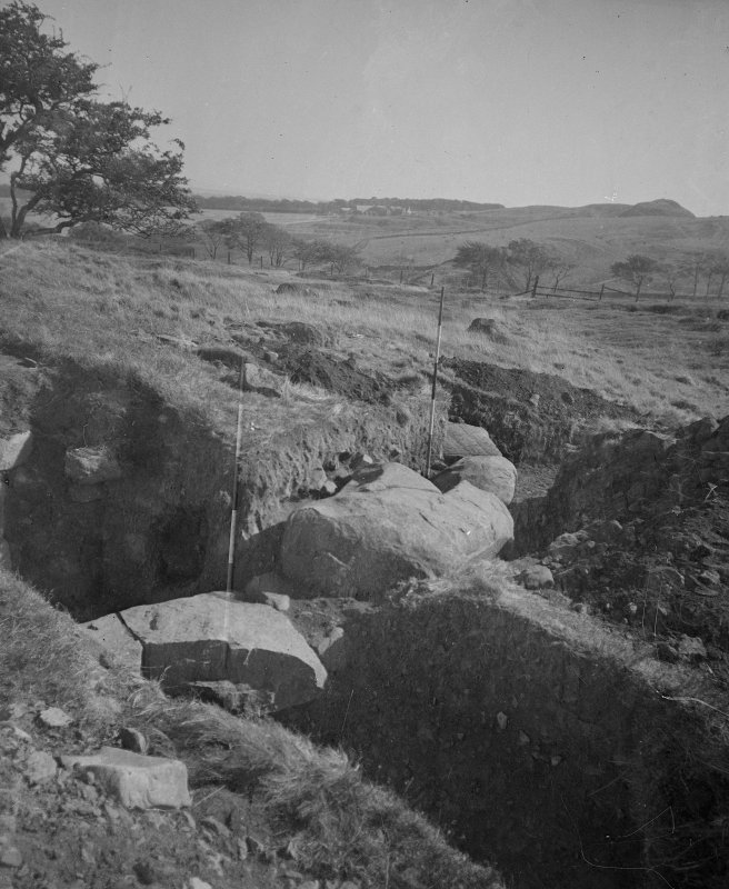 Cairnpapple Hill, photograph of excavation showing kerb stones of Period III cairn on W.