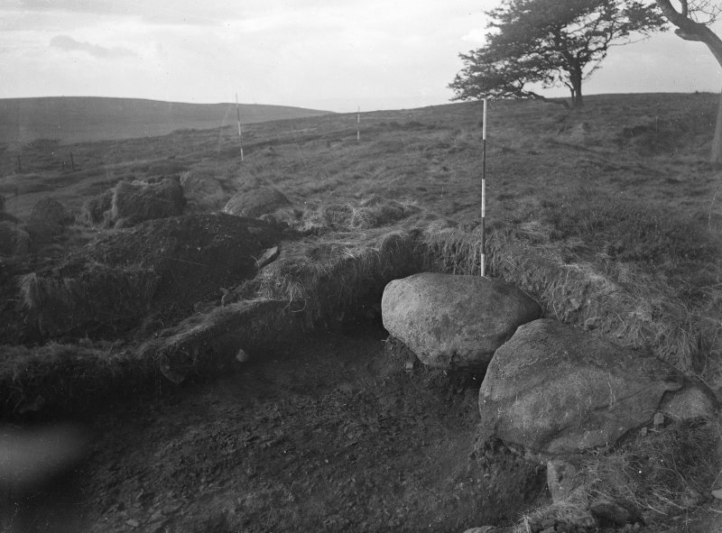 Cairnpapple Hill, photograph of excavation showing kerb stones of Period IV cairn on E side.