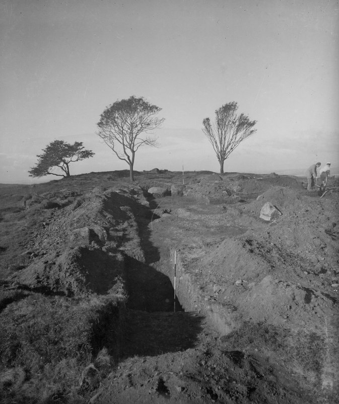 Cairnpapple hill, photograph of excavation showing henge ditch and cairn from E.