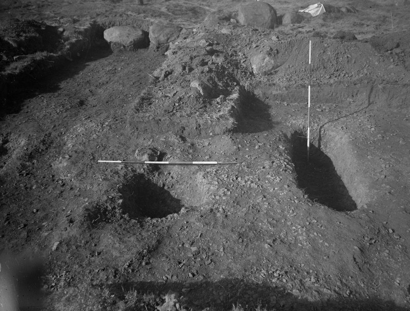 Cairnpapple Hill, photograph of excavation showing stone-hole 7, Inhumation grave 3.
