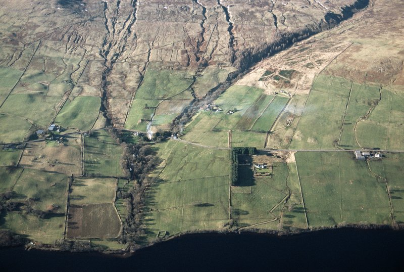 Oblique aerial view of the landscape, field systems and farmsteads on Ben Lawers Farm, to the west of the Lawers Burn, and Machuim and Duallin Farms, to the east of the burn. Taken from SE.