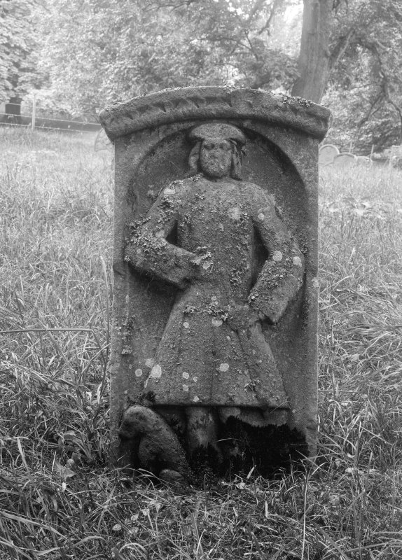 View of carved tombstone with portrait of man.