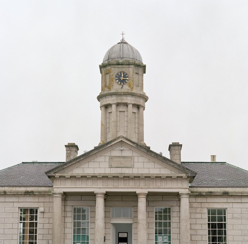 View of clock tower and pediment above main entrance
