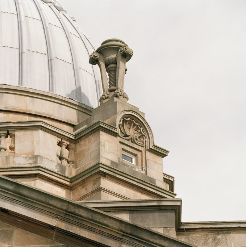 Detail of decorative urn and dormer below dome.
