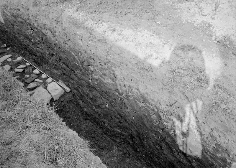 Newstead, Roman forts and temporary camps. Excavation photograph, I A Richmond Agricolan rampart front from W