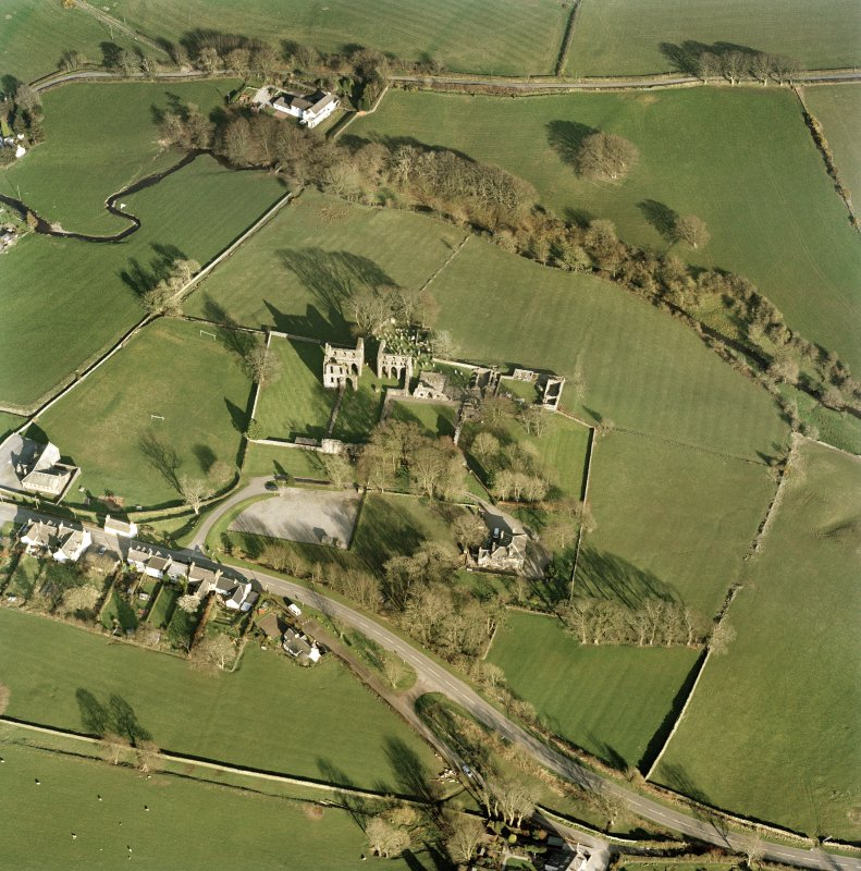 Oblique aerial view centred on the abbey and manse, taken from the west showing the former yards of the abbey.