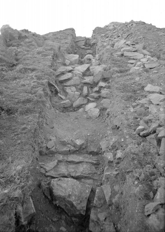 Woden Law, native fort and Roman investing works: excavation photograph. I A Richmond: S section of Dark Age wall, looking N. Undated.