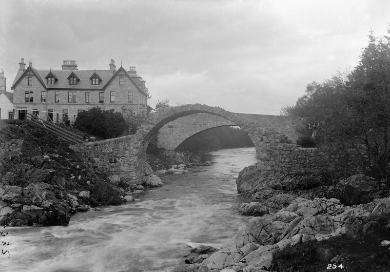 General view of bridges and Carrbridge Hotel with the old bridge in the foreground A Brown & Co Lanark