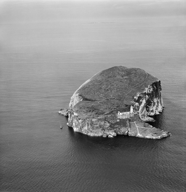 Bass Rock Lighthouse and Castle.  Oblique aerial photograph taken facing north-east.