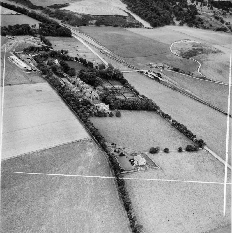 Ladysbridge Hospital and Ladysbridge Station, Boyndie.  Oblique aerial photograph taken facing east.  This image has been produced from a crop marked negative.