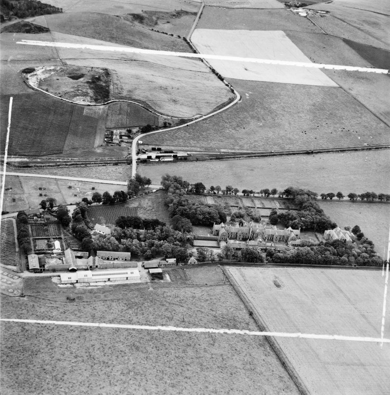 Ladysbridge Hospital and Ladysbridge Station, Boyndie.  Oblique aerial photograph taken facing south.  This image has been produced from a crop marked negative.