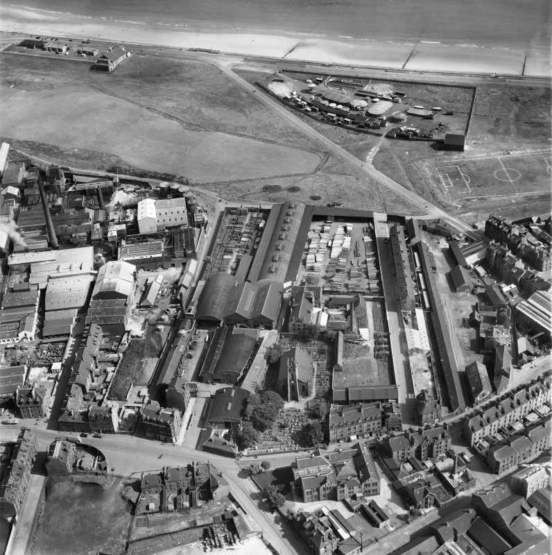 John Fleming and Co. Ltd. Timber Yard and East St Clement's Church, St Clement Street, Aberdeen.  Oblique aerial photograph taken facing north-east.