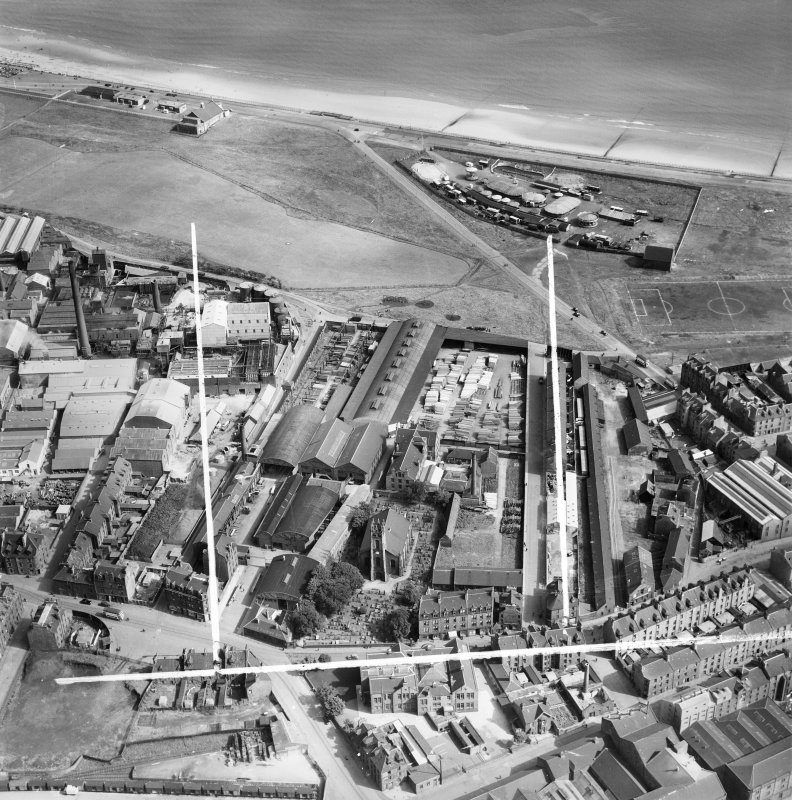 John Fleming and Co. Ltd. Timber Yard and East St Clement's Church, St Clement Street, Aberdeen.  Oblique aerial photograph taken facing north-east.  This image has been produced from a crop marked ne ...