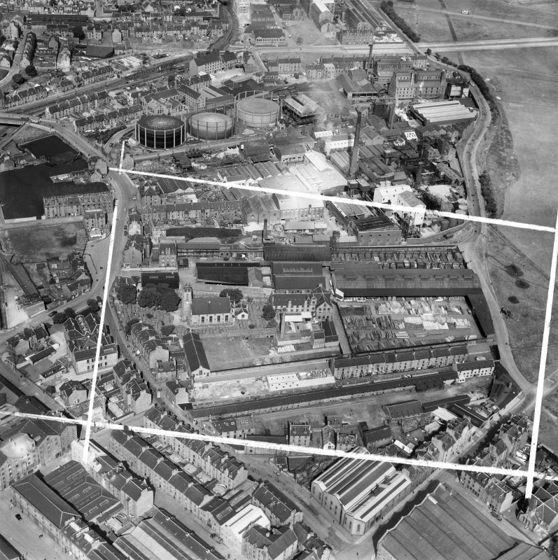 Aberdeen, general view, showing John Fleming and Co. Ltd. Timber Yard, St Clement Street and Aberdeen Gas Works.  Oblique aerial photograph taken facing north.  This image has been produced from a cro ...
