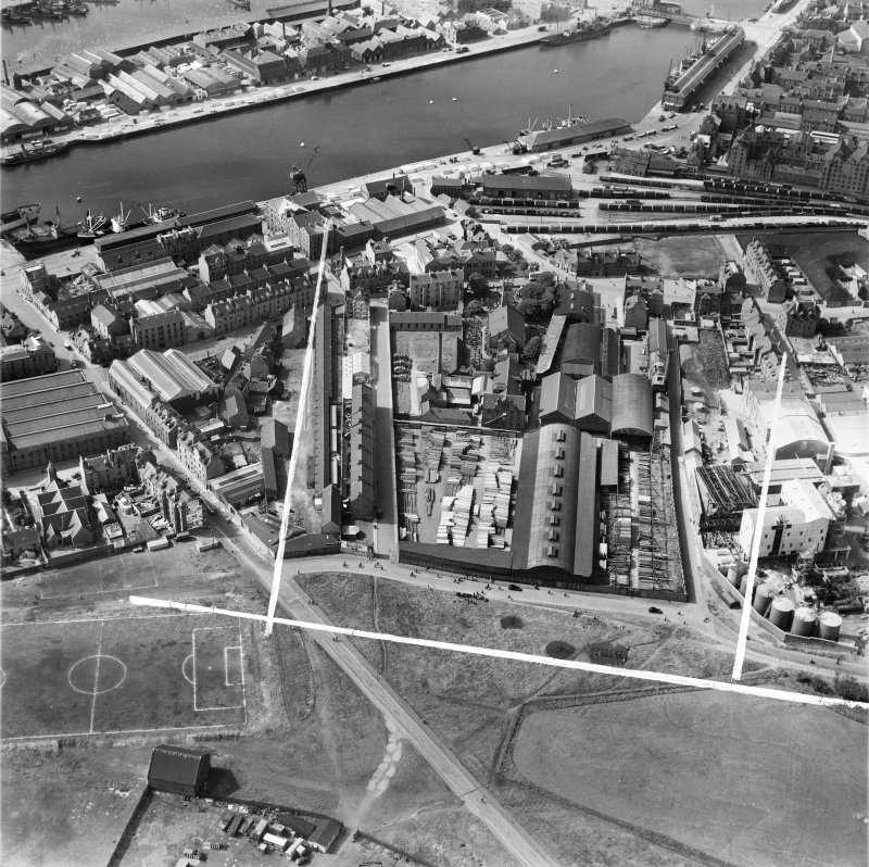 John Fleming and Co. Ltd. Timber Yard, St Clement Street and Victoria Dock, Aberdeen.  Oblique aerial photograph taken facing south-west.  This image has been produced from a crop marked negative.