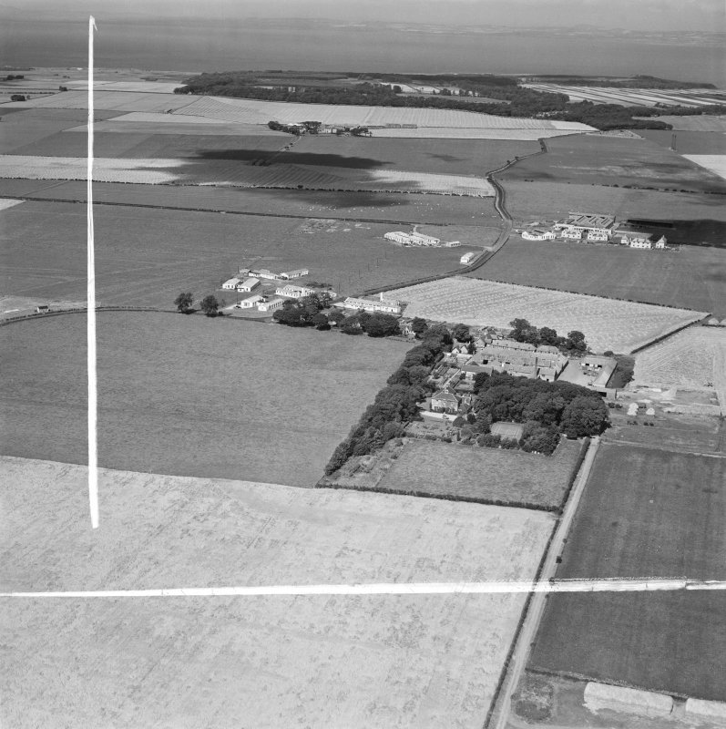 Fenton Barns, Drem, general view.  Oblique aerial photograph taken facing north.  This image has been produced from a crop marked negative.
