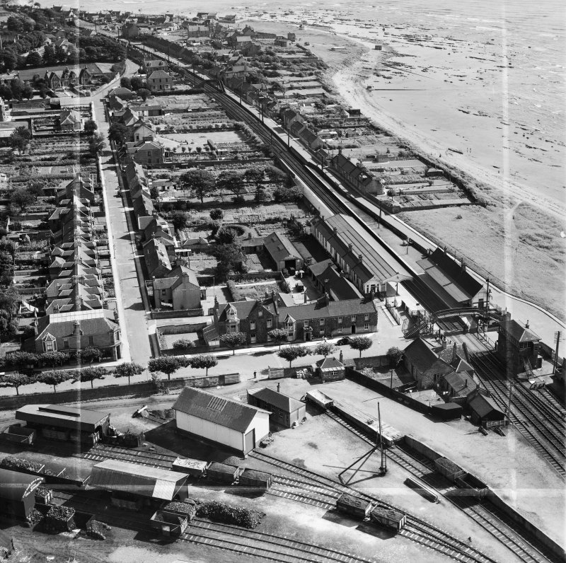 Carnoustie, general view, showing Station Hotel, Station Road and Tayside Street.  Oblique aerial photograph taken facing east.  This image has been produced from a crop marked negative.