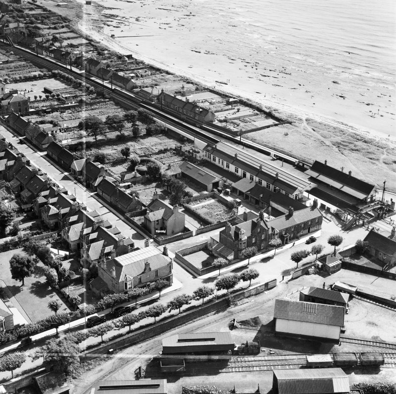 Carnoustie, general view, showing Station Hotel, Station Road and Tayside Street.  Oblique aerial photograph taken facing south-east.  This image has been produced from a crop marked negative.