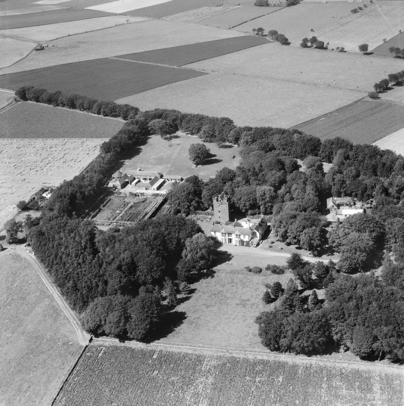 Affleck Castle and Home Farm, Monikie.  Oblique aerial photograph taken facing north.