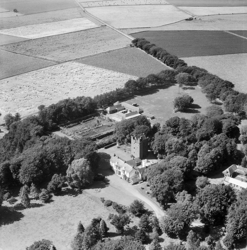 Affleck Castle and Home Farm, Monikie.  Oblique aerial photograph taken facing north-west.