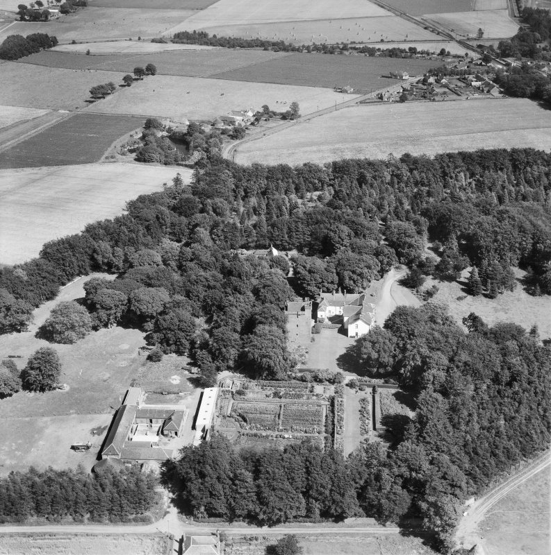 Affleck Castle and Home Farm, Monikie.  Oblique aerial photograph taken facing east.