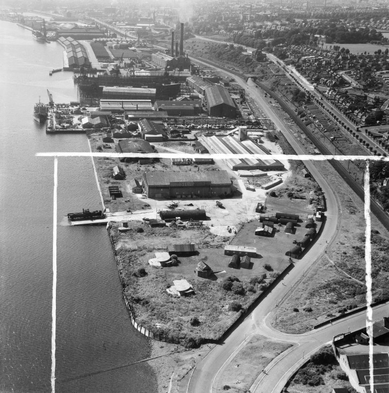 Dundee, general view, showing former Seaplane Base and Caledon Shipyard, Stannergate Road.  Oblique aerial photograph taken facing west.  This image has been produced from a crop marked negative.