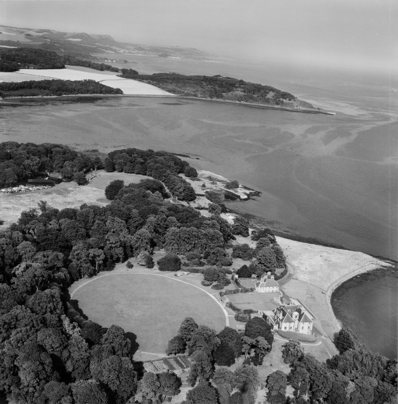 Donibristle House and Dalgety Bay.  Oblique aerial photograph taken facing east.