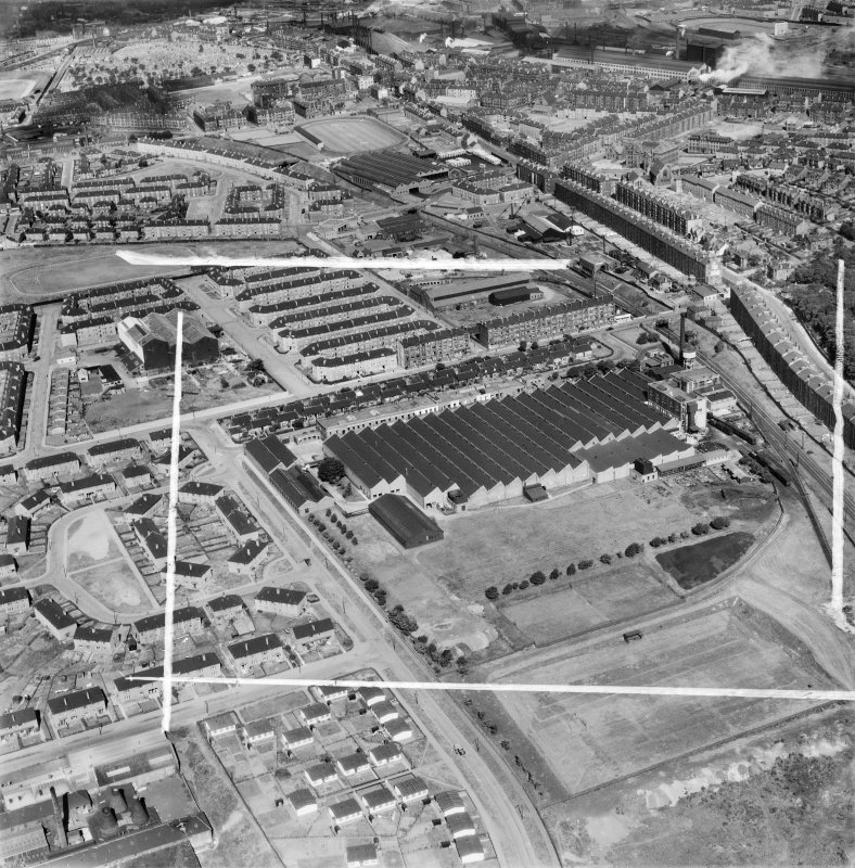 Glasgow, general view, showing Macfarlane, Lang and Co. Victoria Biscuit Works, Clydeford Drive and Tolcross Road.  Oblique aerial photograph taken facing north.  This image has been produced from a crop marked negative.