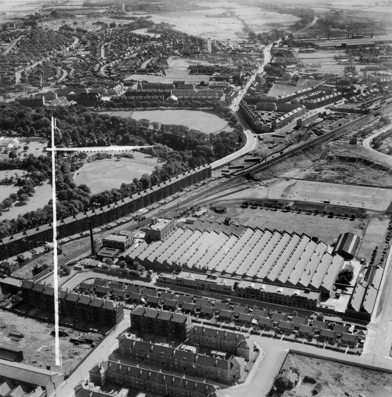 Glasgow, general view, showing Macfarlane, Lang and Co. Victoria Biscuit Works, Clydeford Drive and Tolcross Park.  Oblique aerial photograph taken facing east.  This image has been produced from a crop marked negative.