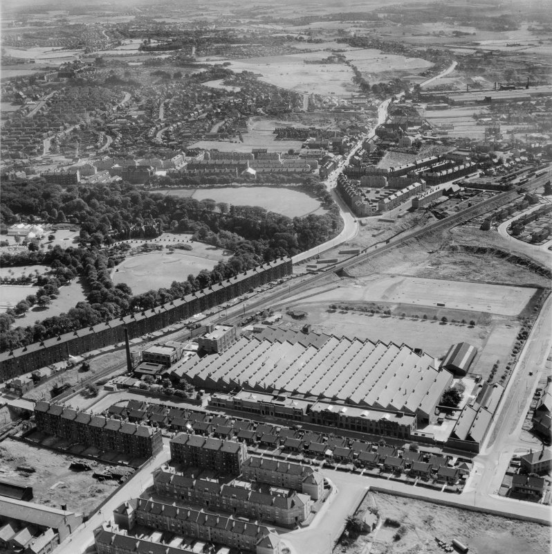 Glasgow, general view, showing Macfarlane, Lang and Co. Victoria Biscuit Works, Clydeford Drive and Tolcross Park.  Oblique aerial photograph taken facing east.