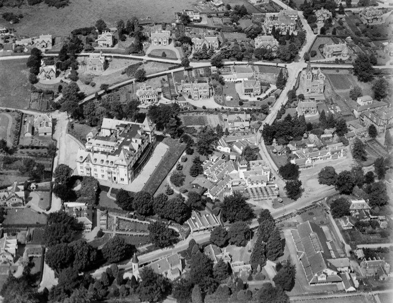 Strathpeffer, general view, showing Highland Hotel and Strathpeffer Free Church.  Oblique aerial photograph taken facing north.