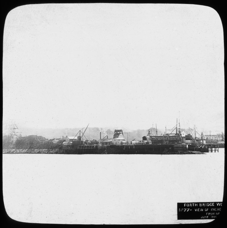 View of construction near to the Inchgarvie Island seen from the North. Insc. 'Forth Bridge Works. No. 77 - View of Inchgarvie from North side. June 1886.'  Lantern slide.
