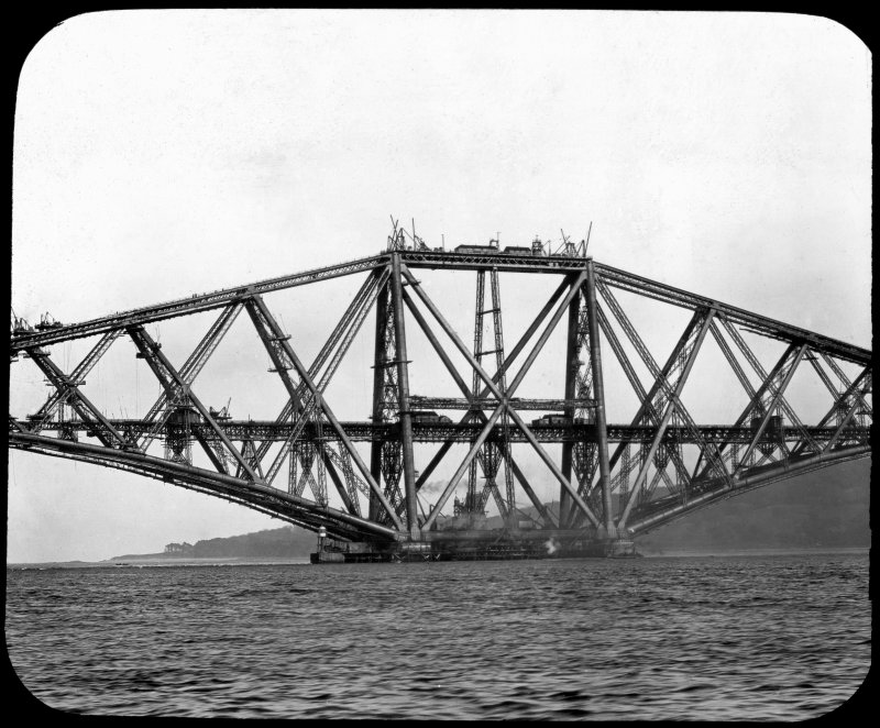 View of one of the erections under construction seen from the Firth of Forth. Insc. 'Cantilever Arms. Registered G.W.W. Trademark.' Lantern slide.