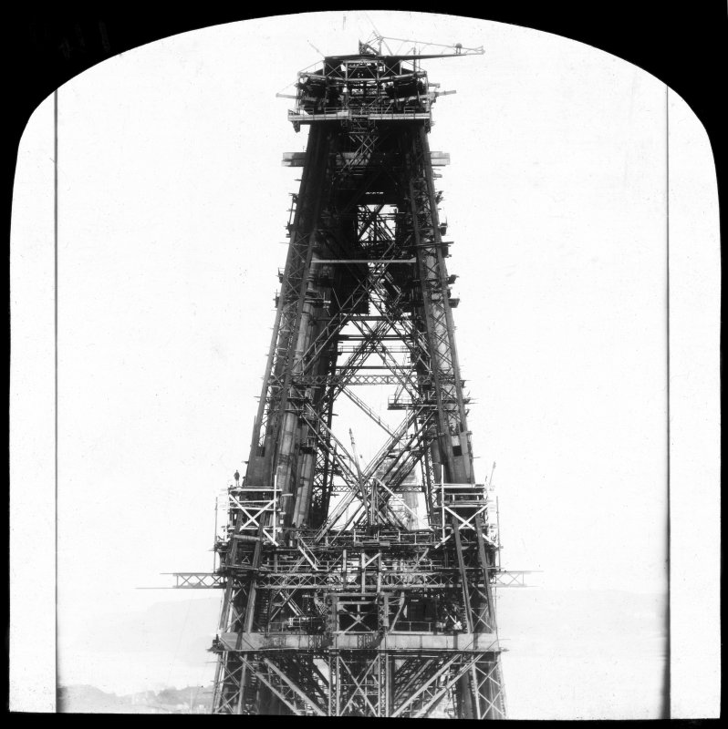 View of one of the cantilevers under construction seen from another cantilever at deck level. Lantern slide.