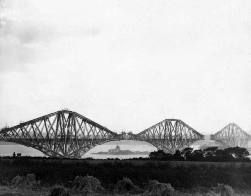 View of the bridge under construction seen from the North West across fields. Lantern slide.