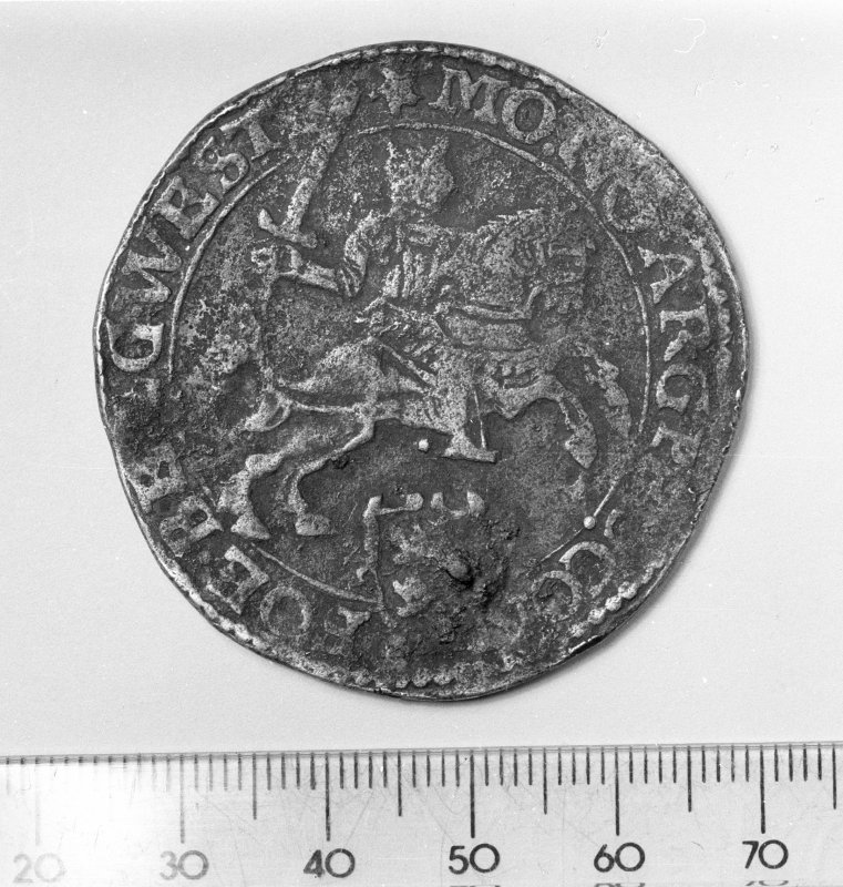 Obverse of a silver ducaton of the United Provinces, date on reverse illegible. Scale in millimetres