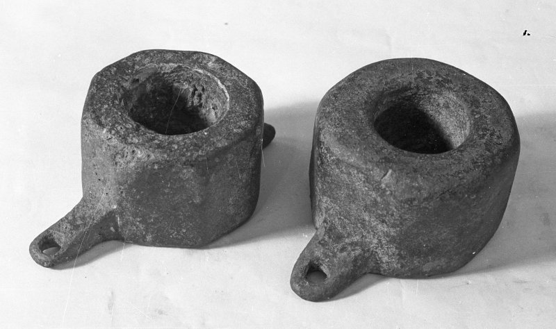 Octagonal copper-alloy bearing coaks, either from the centres of wooden sheaves or possibly the mounting of a swivel-gun. The larger is 9 cm in diameter and 6 cm deep; the smaller 8 cm in diameter and 5 cm deep.