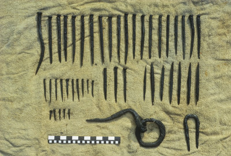 Wrought-iron nails and other fastenings. Scale in inches and centimetres.