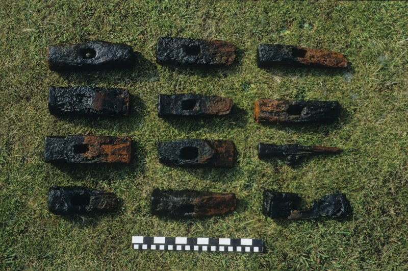 Wrought-iron hammer-heads from the wreck-site. Scale in inches and centimetres.