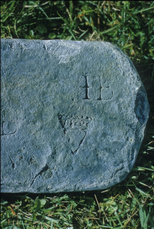 Markings on a Type 1 lead ingot, a crowned V and the letters I B. It is thought that the latter is the mark of John/Joseph Bright, active in the Peak District during the earlier part of the 18th century.