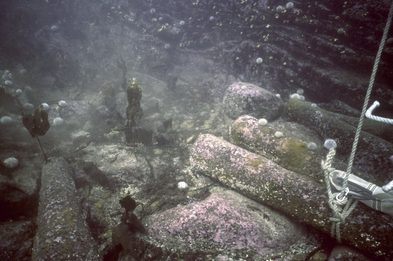 Maritime photographs: Underwater photograph of cannons in situ at the investigation of the wreck, Wrangels Palais (HU77SW 8001).  (Received with Archaeological Diving Unit (ADU) papers).